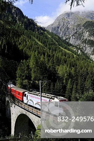 Train of the Rhaetische Bahn RhB Railway travelling on the Albula stretch between Berguen and Preda on a viaduct, Graubuenden, Switzerland, Europe