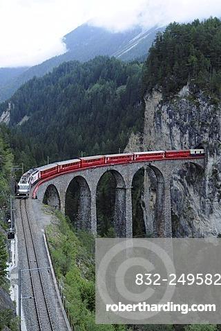 RhB, Rhaetian Railway train crossing the Landwasser Viaduct near Filisur, Albula section, Filisur, Graubuenden, Switzerland, Europe