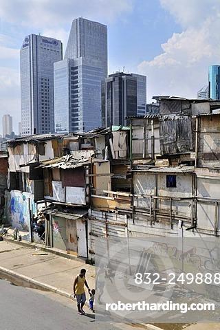 Paraisopolis favela in front of modern skyscrapers, contrast, Morumbi district, Sao Paulo, Brazil, South America