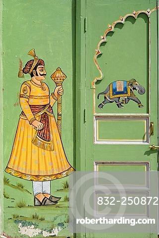 Door painted green with a Maharaja and a running elephant, City Palace, Udaipur, Rajasthan, India, South Asia