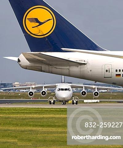 Lufthansa City Jet and a Lufthansa Boeing 747 at the Frankfurt Airport, Frankfurt am Main, Hesse, Germany, Europe