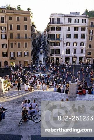 People populating Spanish Steps, Piazza di Spagna, Scalinata della Trinita dei Monti, view from above of the Via dei Condotti, Rome, Italy, Spain, Europe