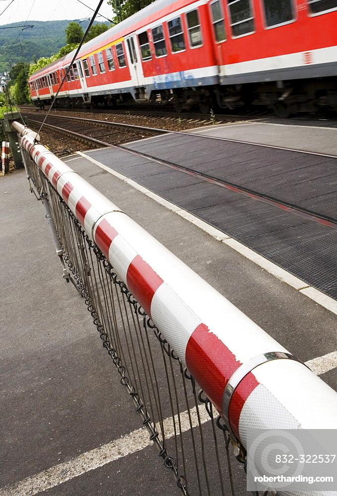 Train passing a closed railroad crossing, Bingen, Hesse, Germany, Europe