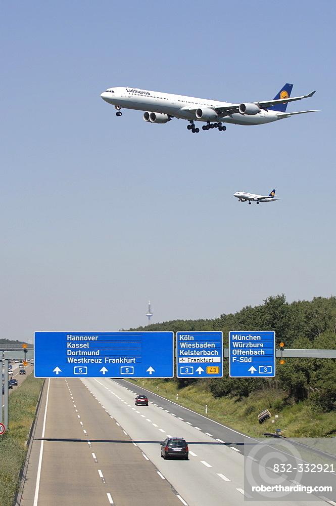 Two Lufthansa jets approaching Frankfurt International Airport for landing in Frankfurt, Hesse, Germany, Europe