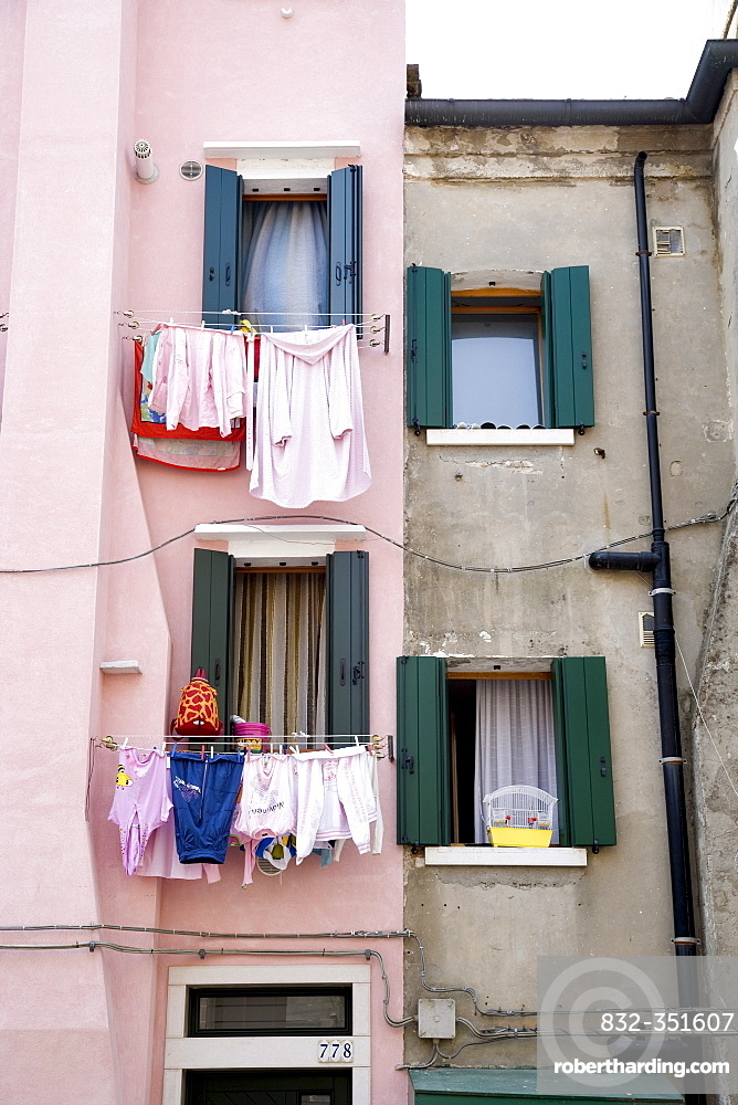 Washing lines on a house wall, Chioggia, Venetian Lagoon, Italy, Europe