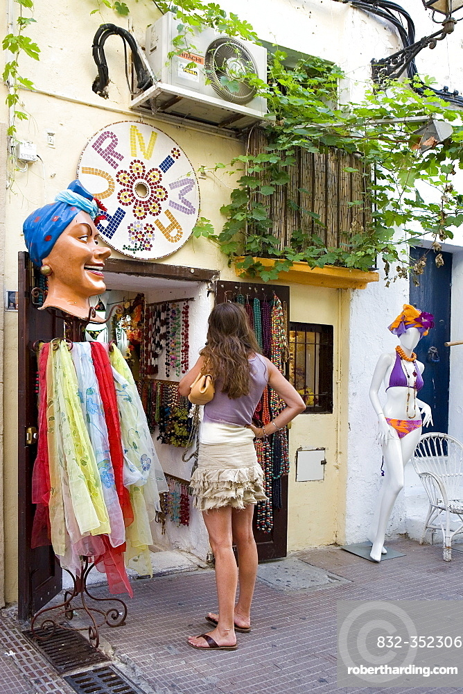 Customer in front of a shop in the historic centre of Dalt Villa, Ibiza, Balearic Islands, Spain, Europe