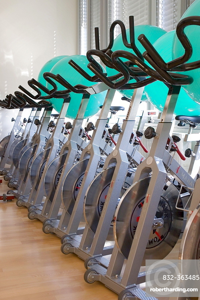 Exercise bikes standing in a fitness room