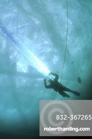 Diver, ice-diving, in Lake Baikal, Olkhon island, Siberia, Russia