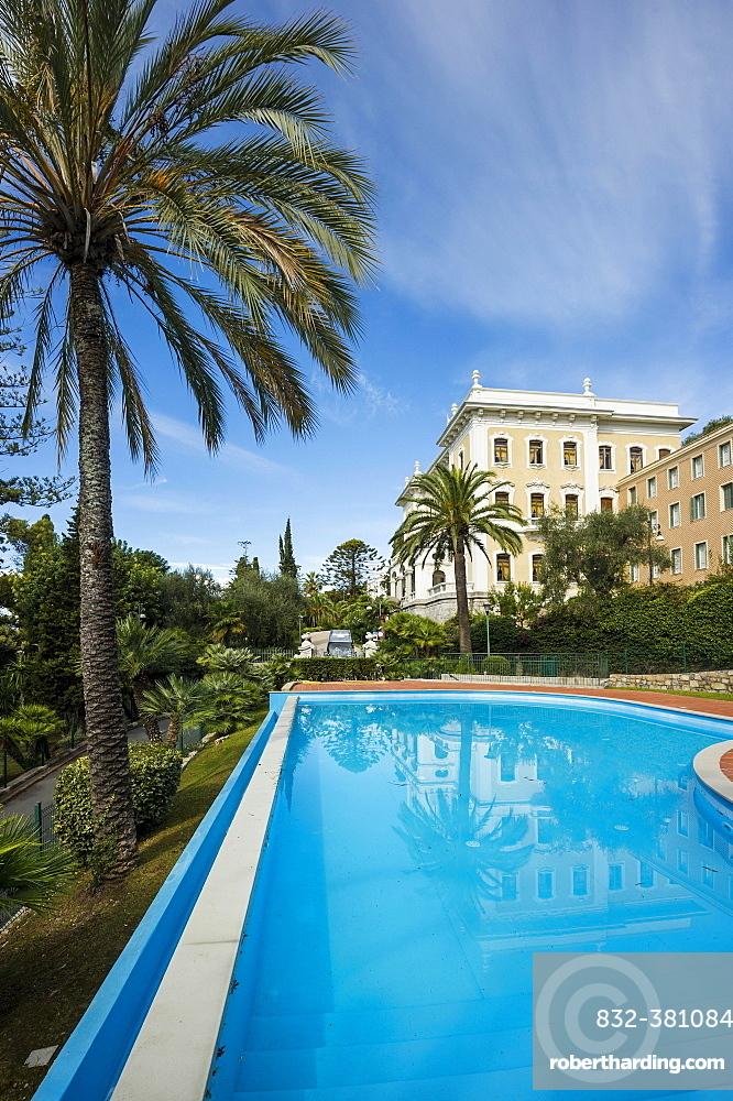 Swimming pool in front of villa, Fondazione Terruzzi, Villa Regina Margherita, Bordighera, Imperia, Riviera dei Fiori, Liguria, Italy, Europe