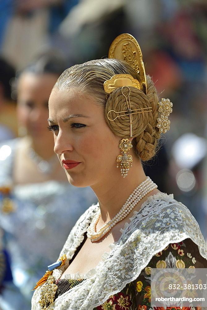 Fallas festival, woman in a traditional costume during the parade in the Plaza de la Virgen de los Desamparados, Valencia, Spain, Europe