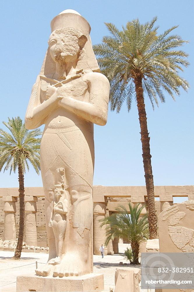 Statue of Ramses II with his daughter Meritamen, Karnak Temple Complex, Thebes, El-Karnak, Luxor, Egypt, Africa