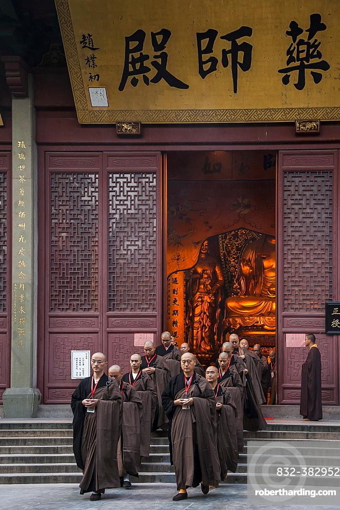 Devout monks leaving a temple, Lingying Monastery, Xihu, Hangzhou, Zhejiang Province, China, Asia