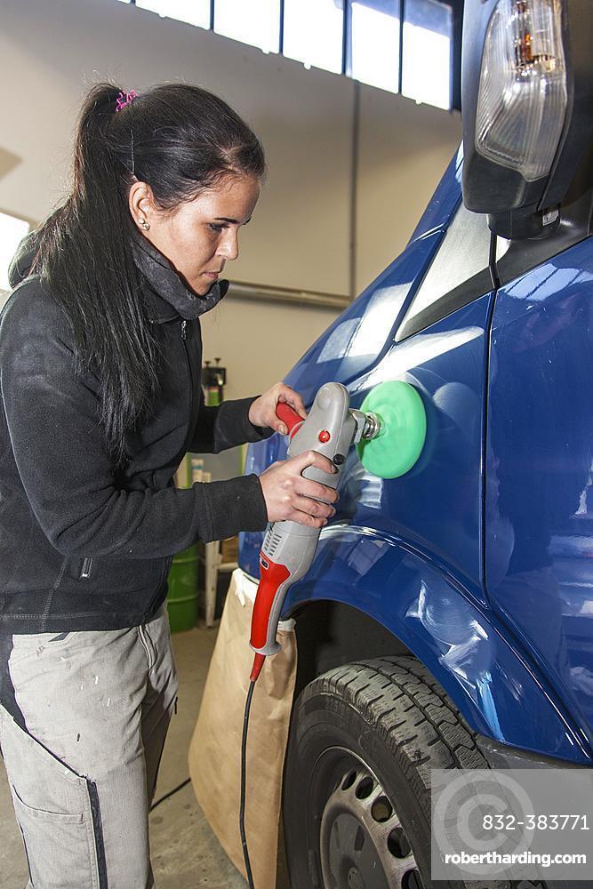 Garage, coachbuilder polishing a vehicle, Dusseldorf, North Rhine-Westphalia, Germany, Europe