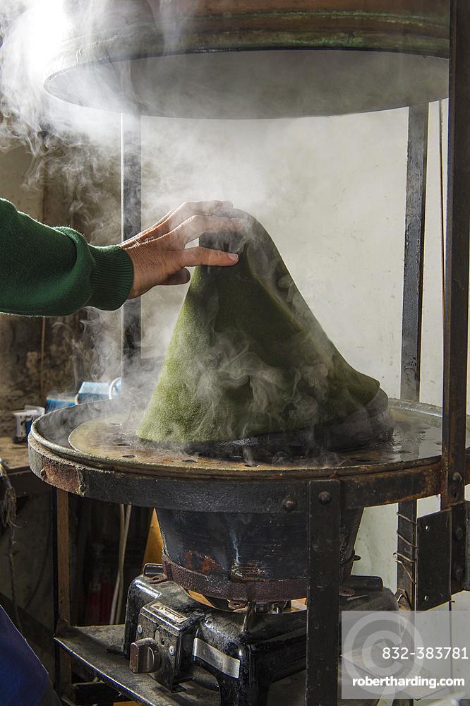 Hand taking hat bodies out of steam boiler, hatmaker workshop, Bad Aussee, Styria, Austria, Europe