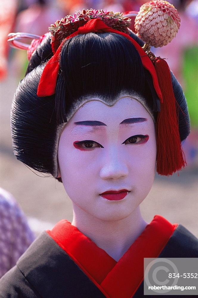 Young girl dressed as a geisha at the Jidai Matsuri Festival held annually in November at Sensoji Temple, Asakusa, Tokyo, Japan, Asia