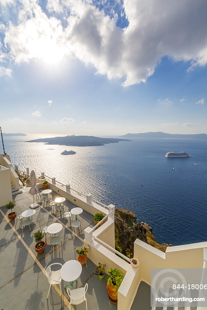 View of Fira restaurant and cruise ship, Firostefani, Santorini (Thira), Cyclades Islands, Greek Islands, Greece, Europe
