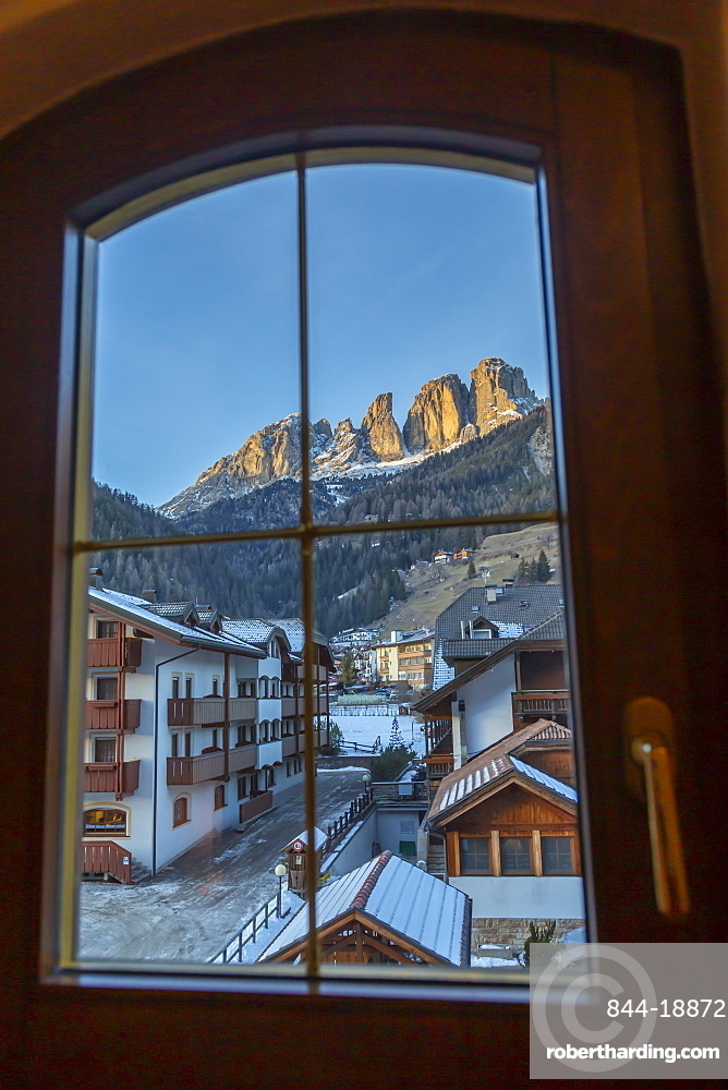 Window view of snow covered Campitello di Fassa and Grohmannspitze Punta Grohmann, Val di Fassa, Trentino, Italy, Europe