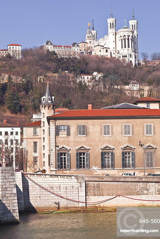 The waterfront in Old Lyon with the Basilica Notre Dame de Fourviere on the hill, Lyon, Rhone-Alpes, France, Europe