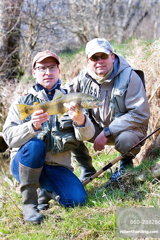 Trout fishing on the Loue river, Presentation of a wild trout (Salmo trutta fario), Franche-Comté, France