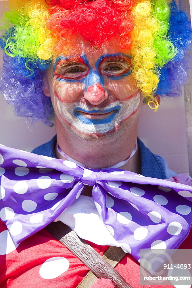 A man dressed up as a clown, Ilfracombe, Devon, England, United Kingdom, Europe