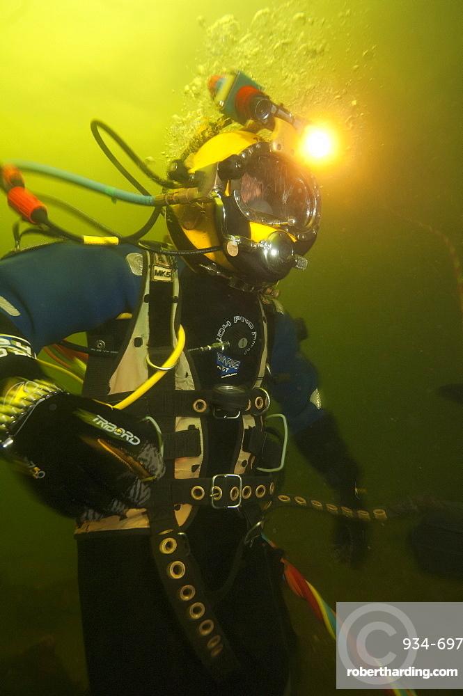 Commercial diver working underwater, Fort William, Scotland, United Kingdom, Europe