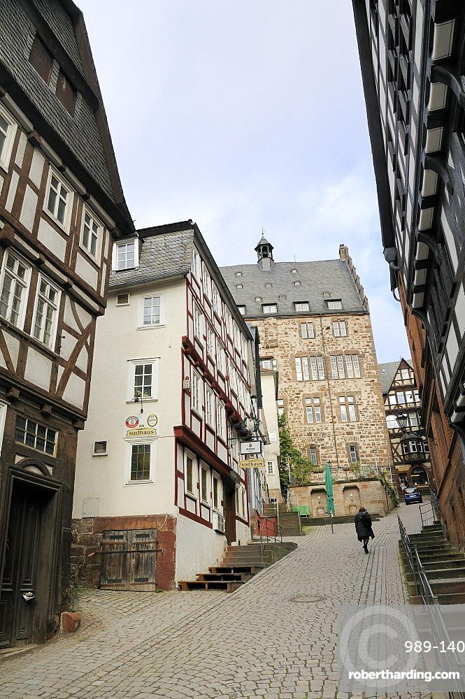 Steep narrow street in medieval city of Marburg, Hesse, Germany, Europe