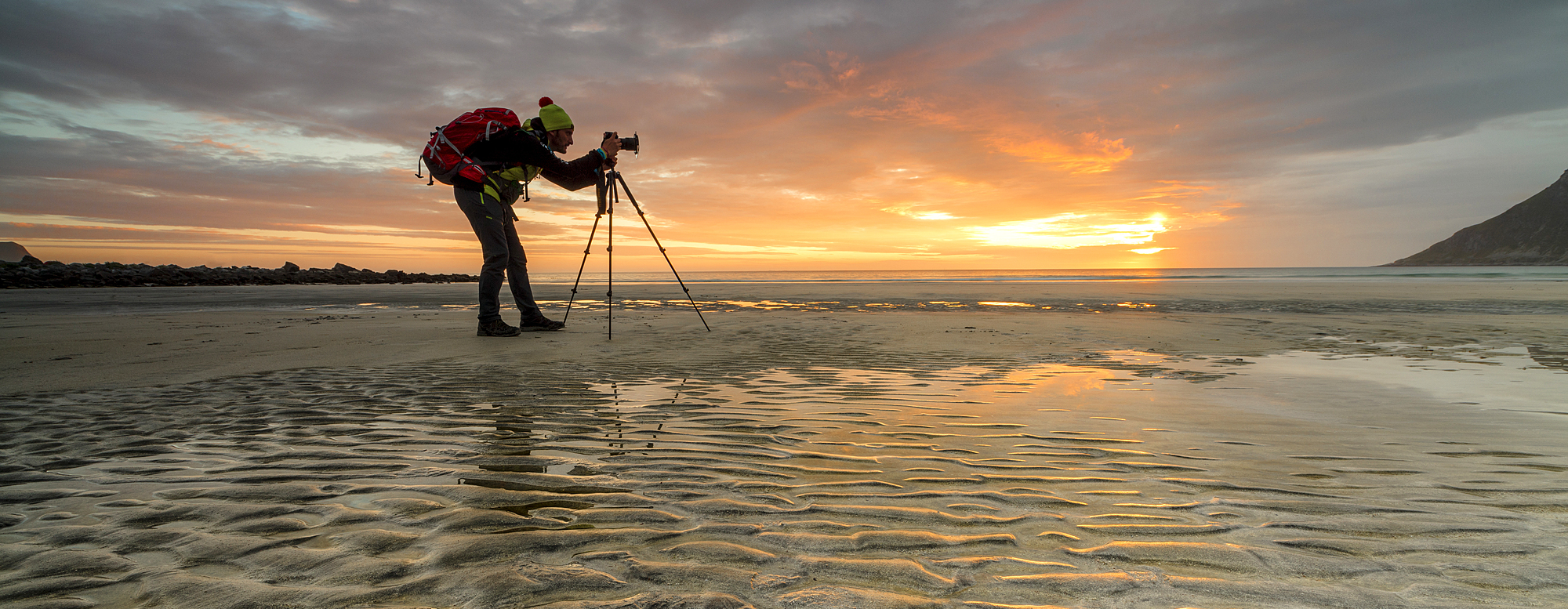 1179-1253 ( Roberto Moiola ) - Midnight sun frames photographer in action on Skagsanden beach, Ramberg, Nordland county, Lofoten Islands, Arctic, Northern Norway, Scandinavia, Europe