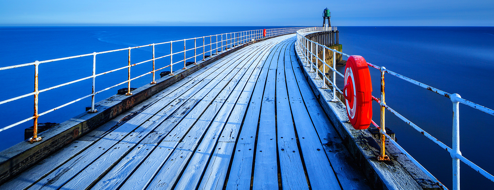 1219-108 ( Garry Ridsdale ) - Frost sits on the timbers of Whitby Pier as it extends out to the sea on a cold winters morning, Whitby, North Yorkshire, Yorkshire, England, United Kingdom, Europe