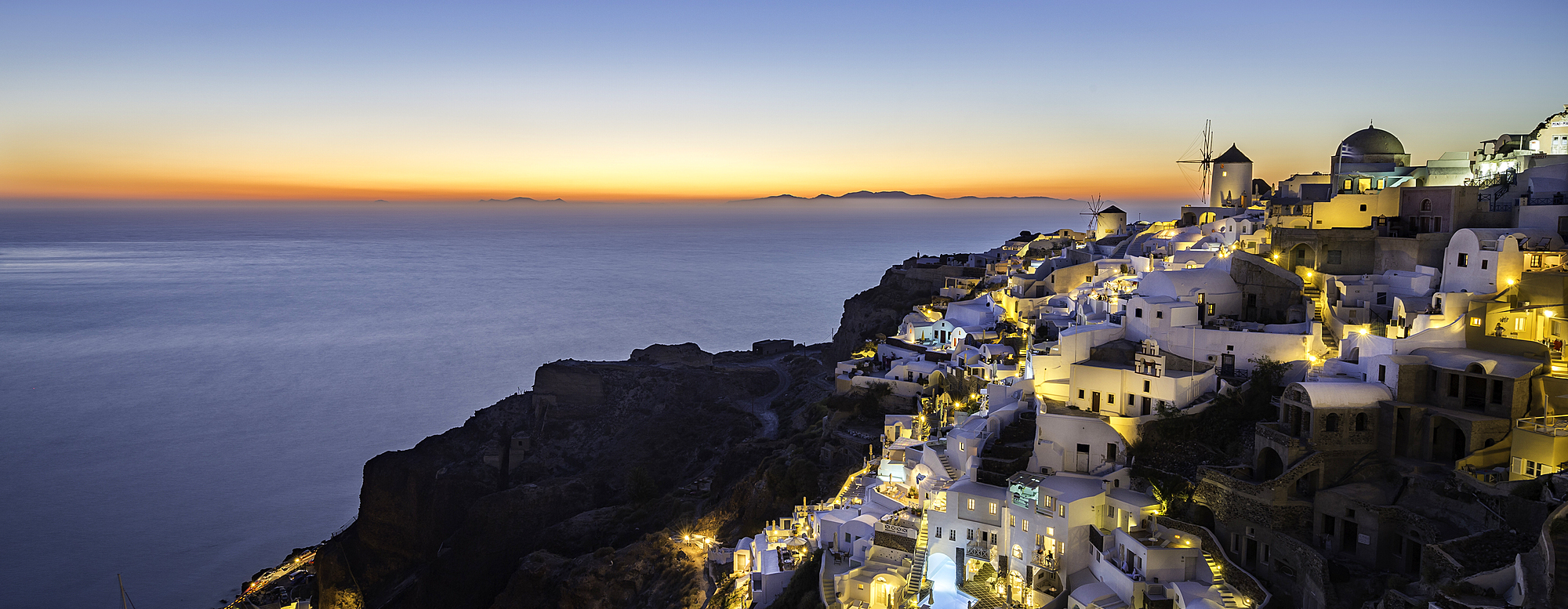 1263-41 ( Matt Parry ) - Long exposure sunset view over the whitewashed buildings and windmills of Oia, Santorini, Cyclades, Greek Islands, Greece, Europe
