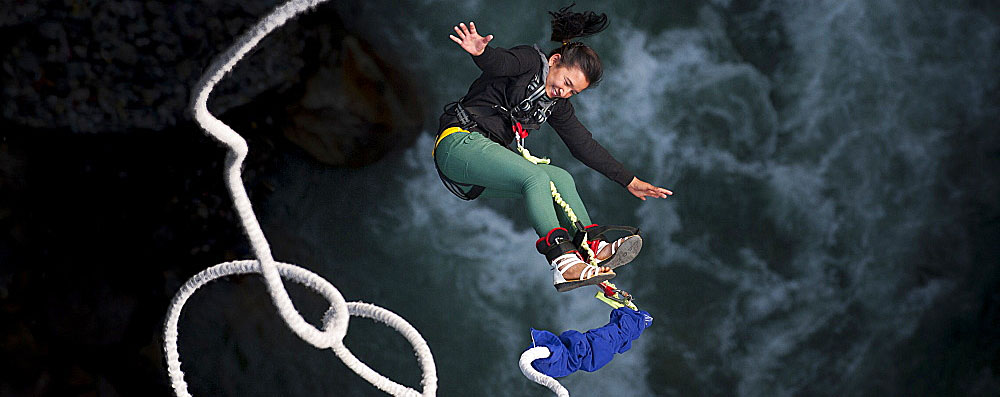 1225-740 A Nepali girl bungy jumping at The Last Resort in Nepal, Asia